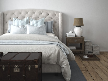 Spring clean bedrooms. Beautifl beige and light blue pillows and comforter in a modern bedroom.