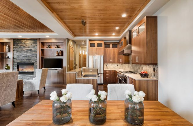 Here's why you should charge more for the first house cleaning. Modern home with wood floors.