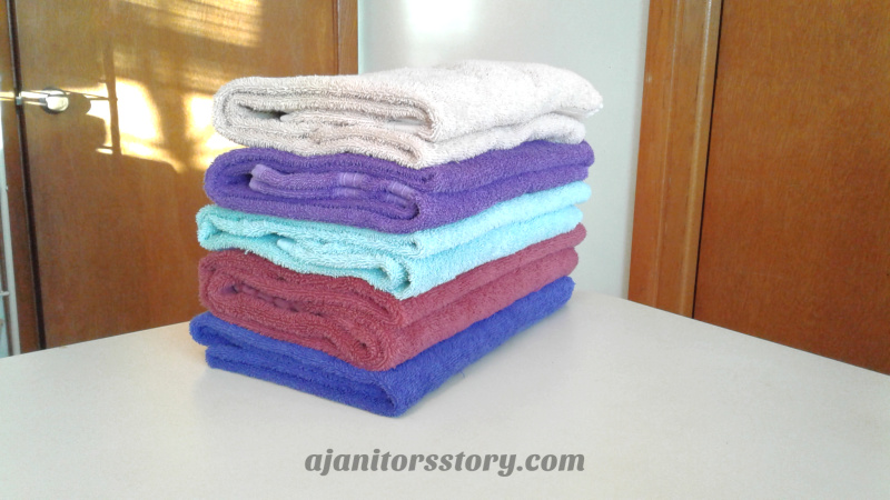 Calculate folding laundry like this colorful stack towels when creating a house cleaning pricing guide. Learn how to profit from every cleaning job by charging the right amount… especially on the initial cleaning! FREE Printable!! residential house cleaning business | residential maid services | cleaning business tips #ajanitorsstory #cleaningbusiness #professionalhousecleaning