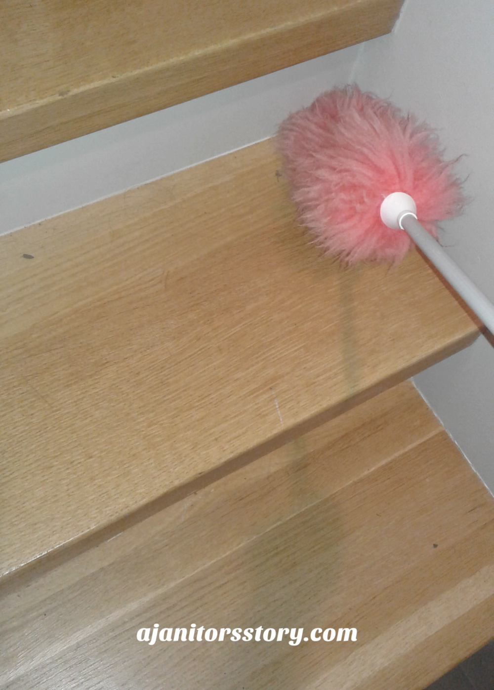 Pink duster cleaning wood steps. Best cleaning products for housekeeping. Traditional, natural, and non toxic cleaning supplies list.