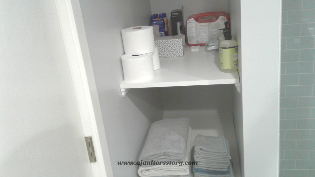 clean and organize the bathroom linen closet and vanity. shelves with tissue 1st aid kit and gray towels