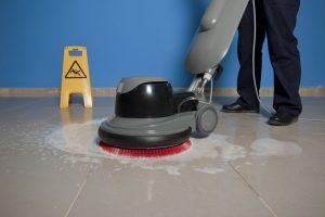 gray floor scrubber on gray floor tile