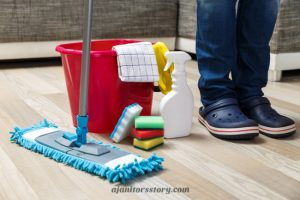 Cleaning service ready to do a house cleaning pricing guide with a red bucket, flat mop, spray bottle, sponges and yellow gloves. Learn how to profit from every cleaning job by charging the right amount… especially on the initial cleaning! FREE Printable!! residential house cleaning business | residential maid services | cleaning business tips #ajanitorsstory #cleaningbusiness #professionalhousecleaning