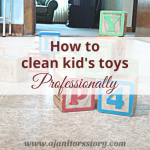 how to clean kid's toys. colorful wooden locks on solid floor with house in the back
