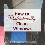How to clean windows. Picture of white bucket, squeegee, blue scour pad, dawn, scraper.