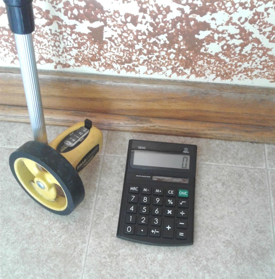 price office cleaning by the hour with a measuring stick and a calculator