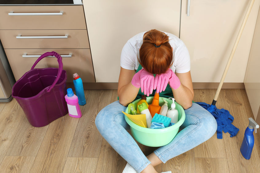 red headed girl discouraged over house cleaning business