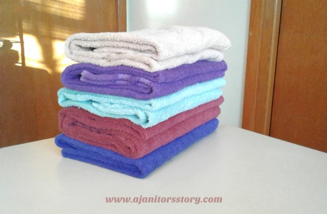 why how wash towels. blue, red, green, purle, beige towels folded on a table.